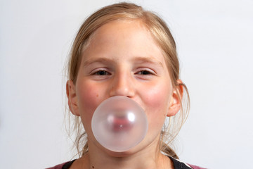 Girl blowing a  bubble gum bubble