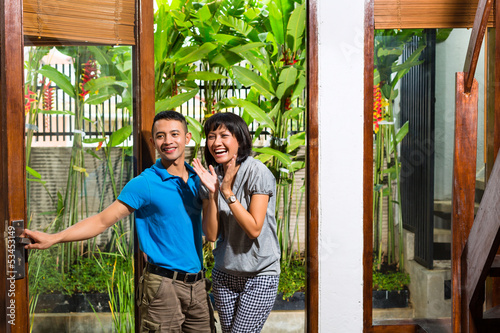 Asian couple moving in the new home