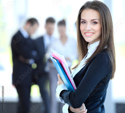 canvas print picture Face of beautiful woman on the background of business people