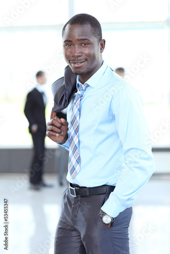 Portrait of a handsome successful business man busy working