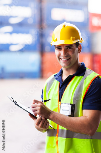 young shipping company worker at harbor container depot