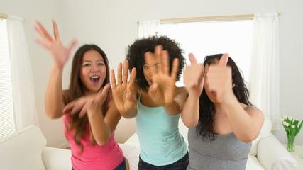 Three girls singing and dancing