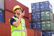 harbor worker talking on the walkie-talkie - 53460348