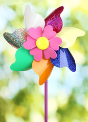 Colored pinwheel on bright background