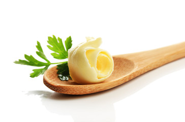 Butter curl on wooden spoon, isolated on white