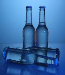 Water bottles on blue background