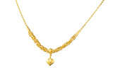 A luxury golden necklace with pendant in heart shape