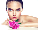 Beauty portrait. Beautiful spa girl with peony flower