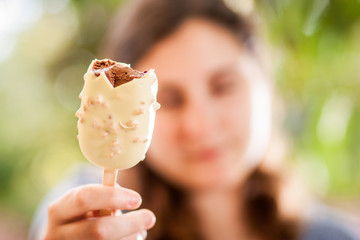 White and brown chocolate ice-cream held by girl