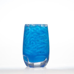 Blueberry flavor aerated drinks whit ice in glass isolated