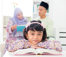Muslim girl reading book.