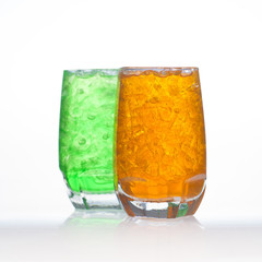 Orange flavor aerated soft drinks with soda and ice in glass