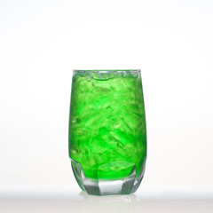 Green fruit flavor soft drinks whit soda water isolated