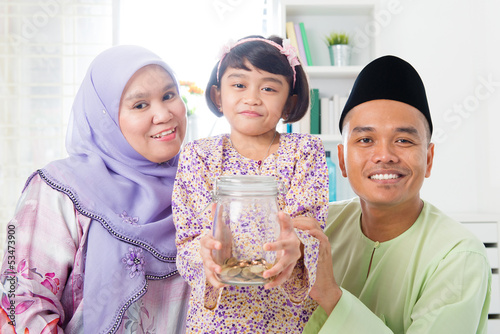 Malay family saving money