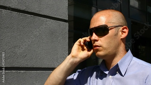 Close up of a businessman in sunglasses having a call