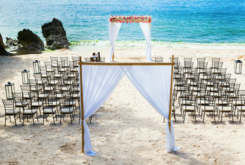 Wedding arch and chairs on the beach