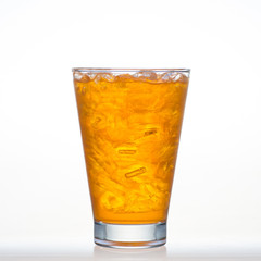 Orange flavor drink with sparkling soda in glass isolated