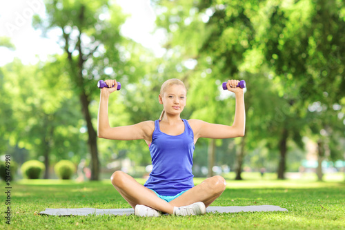 Female exercising with dumbbells