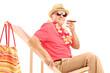 Gentleman smoking a cigar and enjoying on a sun lounger