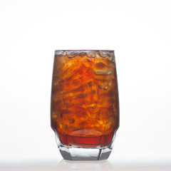 Root beer flavor aerated drinks with soda in glass isolated