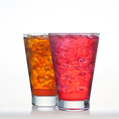 Red fruit and root beer flavor soft drinks with soda water