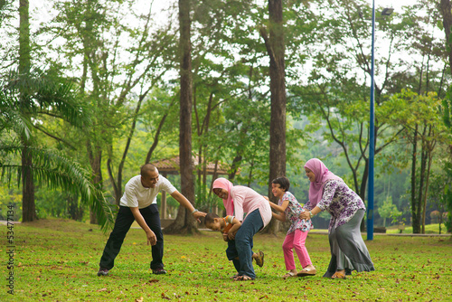 Muslim family having fun at outdoor