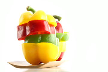 Slice the Three color of bell pepper in Arranged vertically.