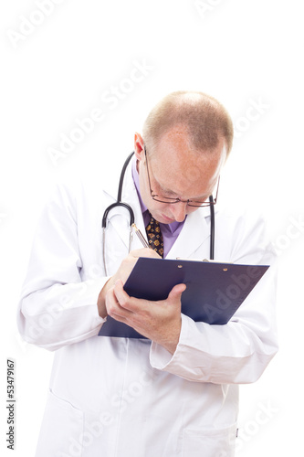 Male doctor making some important notes for diagnosis