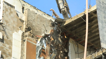 A demolition crane in action.Find similar clips in our portfolio
