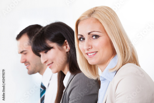 Close Up Of Happy Business People In A Row