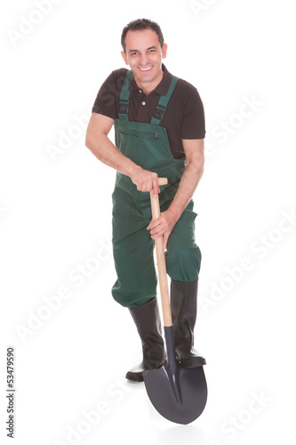 Portrait Of A Male Worker Holding A Shovel
