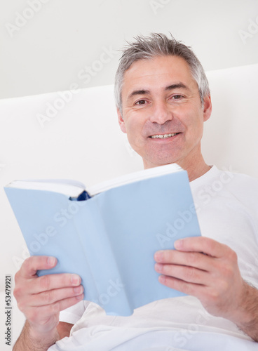 Mature Man Holding Book