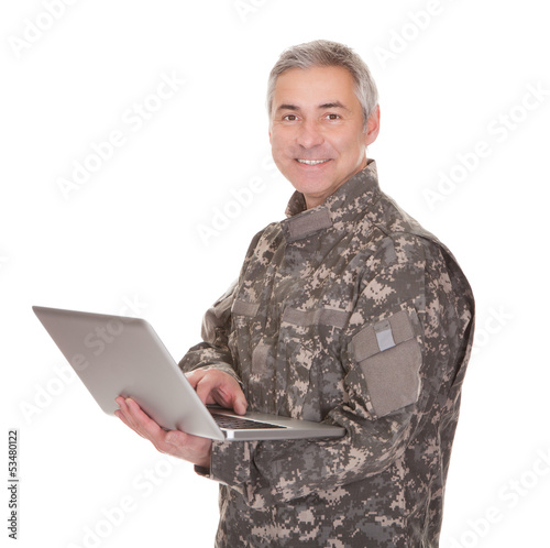 Mature Soldier Holding Laptop