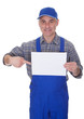 Mature Male Technician Holding Empty Sheet