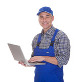 Mature Male Technician Using Laptop