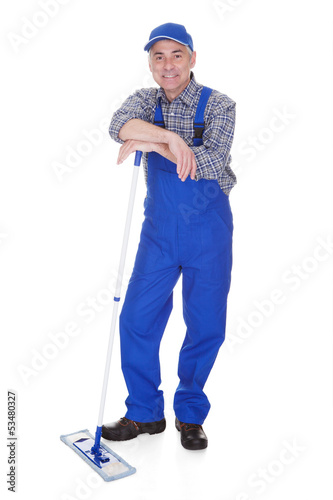 Mature Man Cleaning Floor With Mop