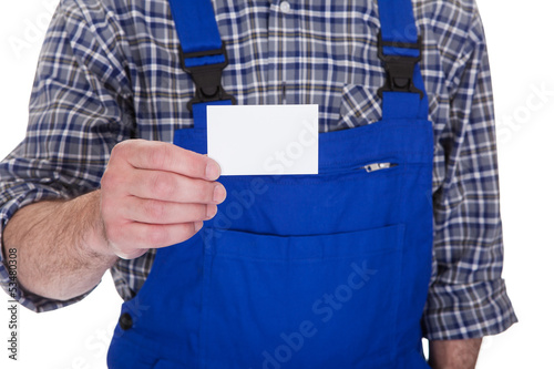 Mature Male Technician Holding Visiting Card