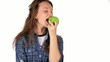 Girl eating a green apple on white background