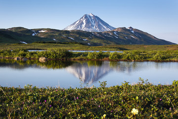 Viliuchinsky Volcano and the reflection in a mountain lake