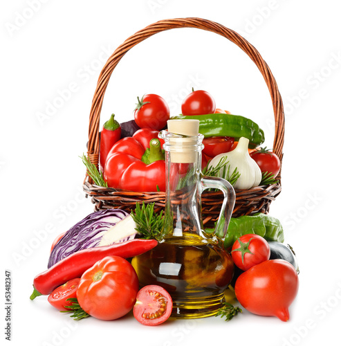 Vegetables in a basket and olive oil