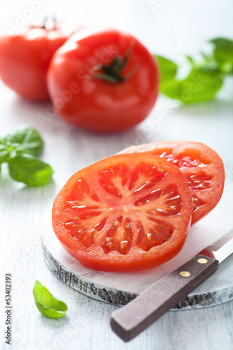 beef tomato sliced on cutting board