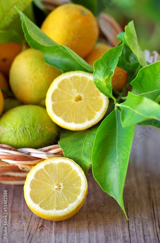 Basket of lemons and half lemons on table