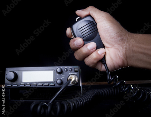 hand of Amateur radio holding speaker and press