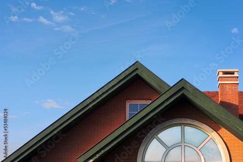 modern chalet roof with attic windows