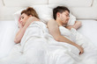 Young couple sleeping on bed