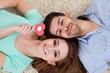 Happy young couple lying on back