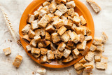 bread croutons on a plate, top view