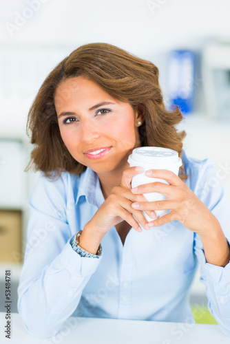 businesswoman enjoys her break with a cup of coffee