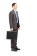 Full length portrait of a young businessman with briefcase stand