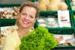 attractive woman buys leaf lettuce